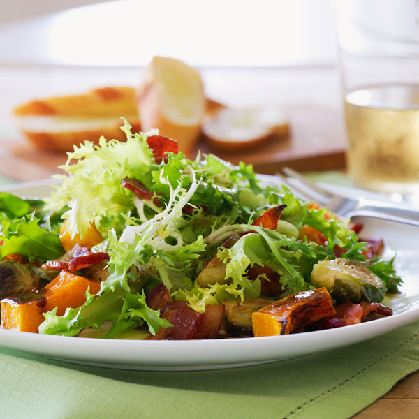 Warm salad with roasted squash and brussels sprouts