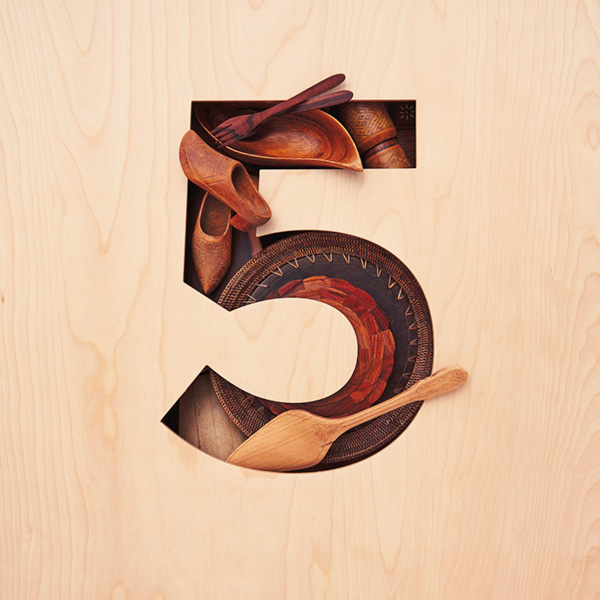 5-anniv-ideas The number 5 (for 5th anniversary) cut from a piece of light-colored wood, filled with objects carved from wood (for the traditional 5th anniversary gift)