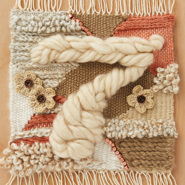 7-anniv-ideas The number seven (for 7th anniversary) braided in chunky, off-white woold roving (wool is one of the traditional 7th anniversary gifts) on a background weaving that includes peach, tan and off-white yard and crocheted flowers