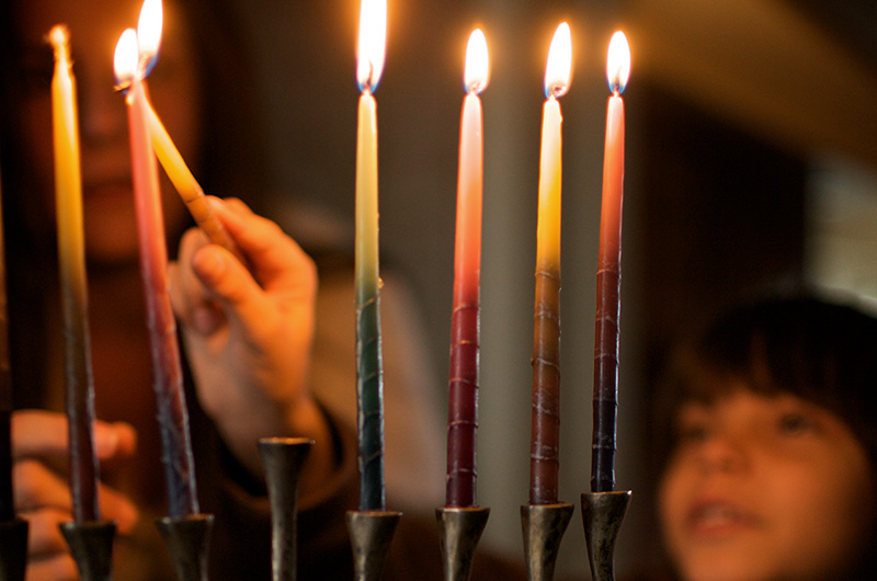 How to Make Meaningful Holiday Traditions - Lighting Candle
