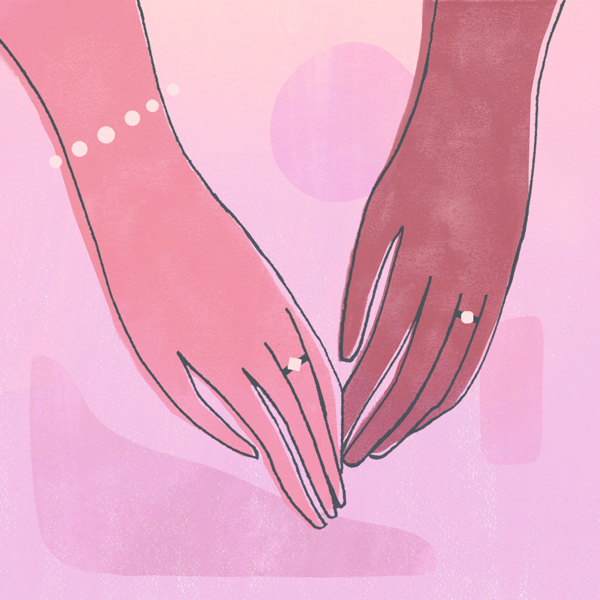 two women holding hands