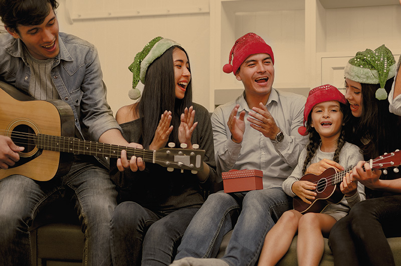 Family singing - Latinx Christmas Traditions and Holiday Celebrations
