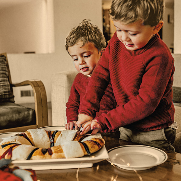 Kids with holiday food - Latinx Christmas Traditions and Holiday Celebrations