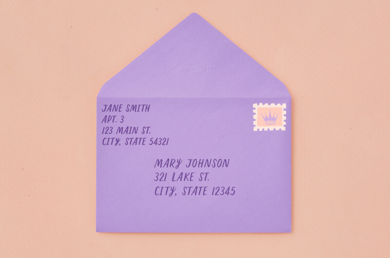 The stamp goes in the top right of the envelope. This image shows an enveloped addressed with a stamp.