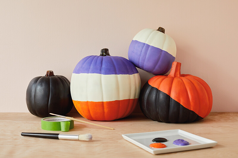 Painted pumpkins with bold color blocks