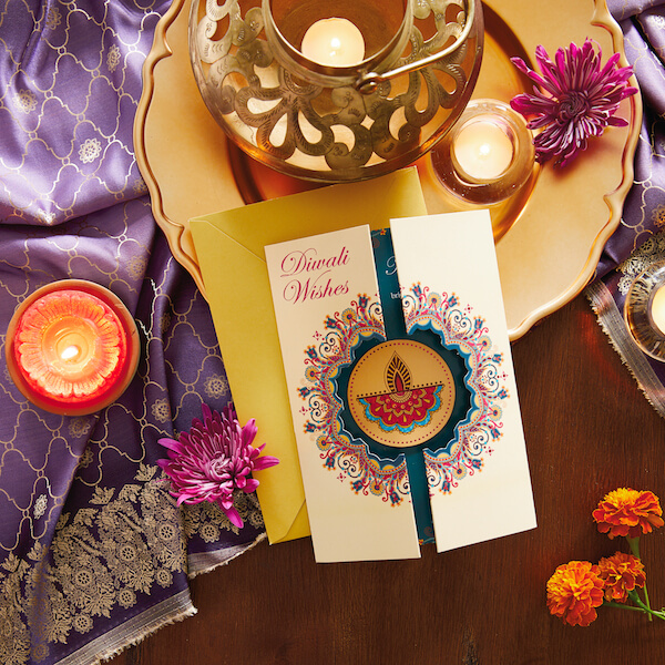 Diwali Card with candles, fabric and flowers