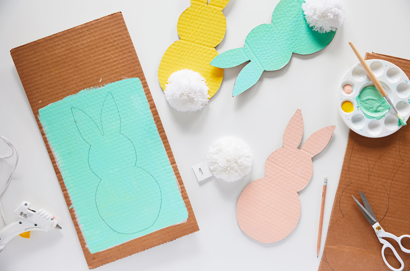 Making cardboard Easter bunnies with paint and craft supplies