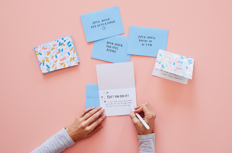Hand writing encouraging notes for parents