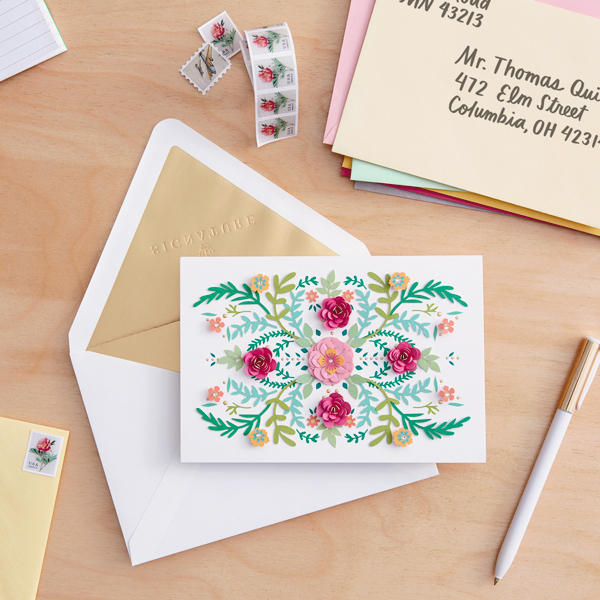 card and envelope on desk with pen