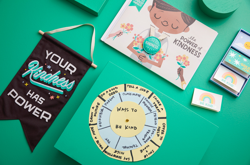 Banner, spinner, cards and book on green background