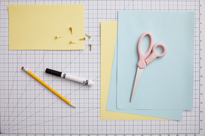 Pencil, marker, paper and scissors