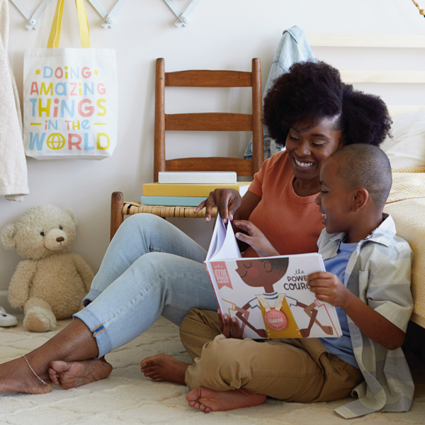 Mother and son reading book about courage