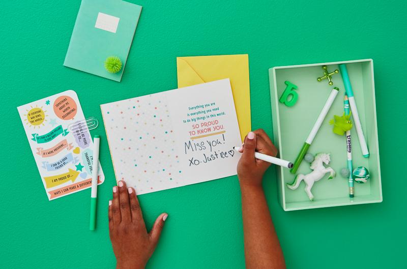 Kid writing in card