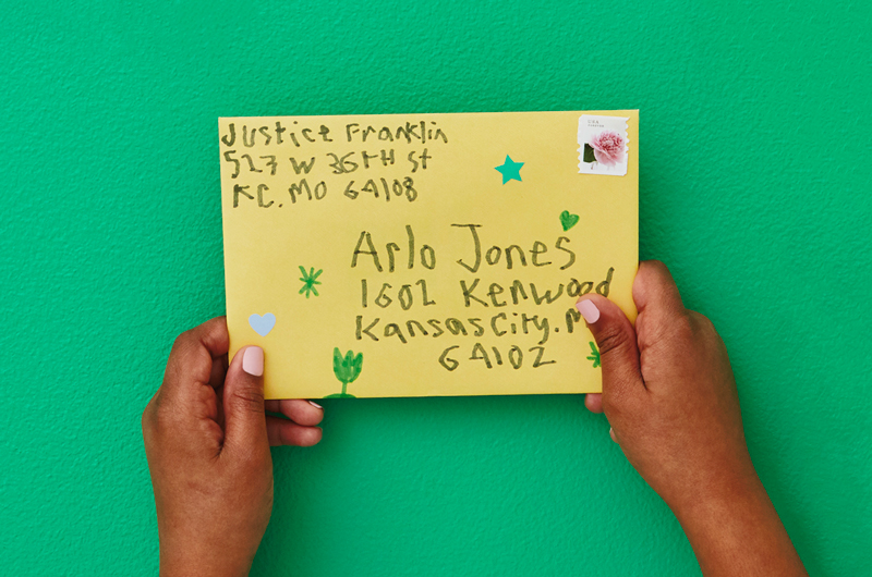 Kids hands holding envelope