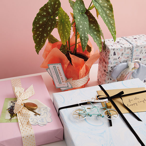 Personalized gifts on table with plant