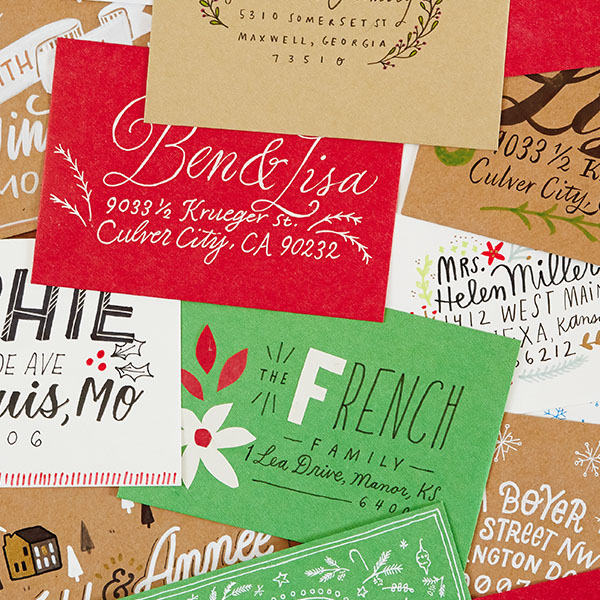 PIle of decorated and hand-lettered envelopes in various colors.
