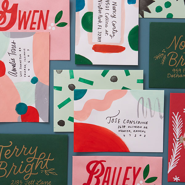 Christmas cards decorated with paint, stamps and hand-lettering.