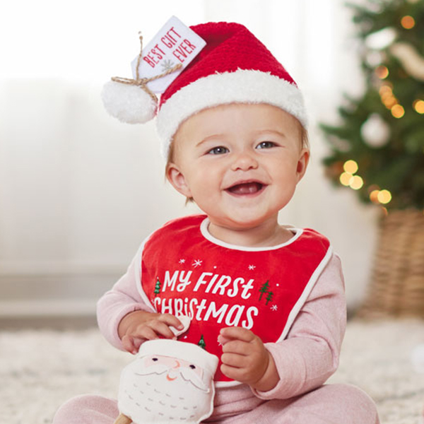 Baby with Santa hat and bid that reads