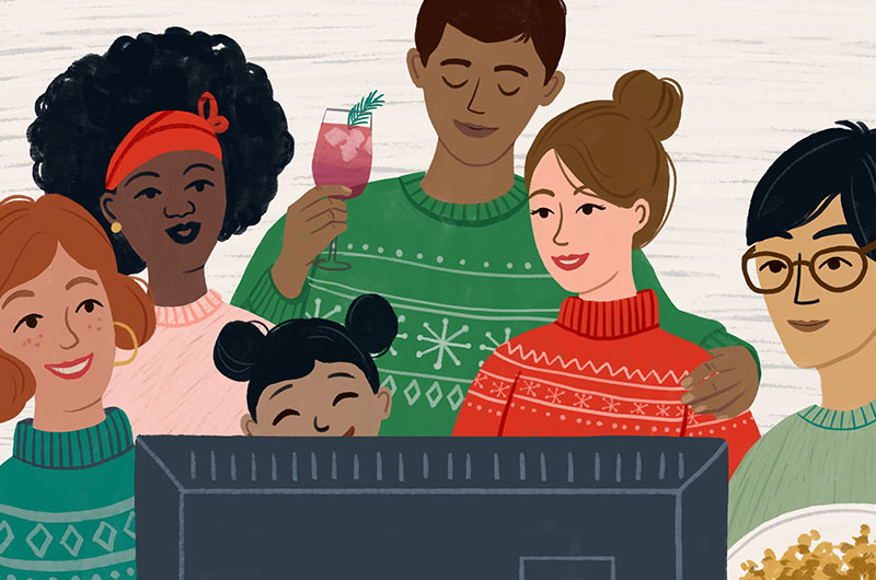 Group of people in holiday sweaters watching Christmas movies